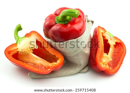 Ripe red sweet pepper with sack isolated on white background - stock photo