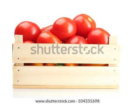 Ripe red tomatoes in wooden box isolated on white - stock photo