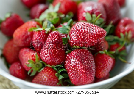 Ripe strawberries in a bowl for breakfast. - stock photo