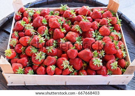 Ripe strawberries in wooden crate