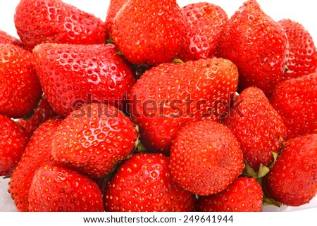 Ripe strawberries isolated on the white background - stock photo