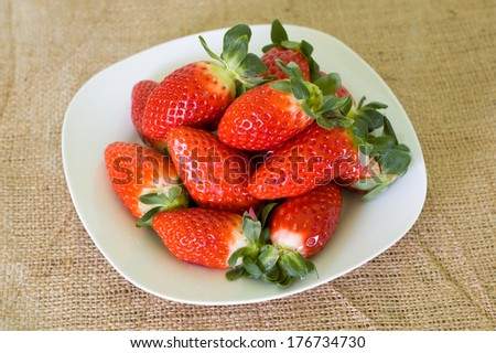 ripe strawberries on a plate - stock photo