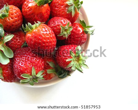 Ripe strawberries on the saucer isolated on white background close-up - stock photo