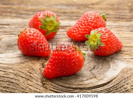 Ripe strawberries over wooden  background - stock photo
