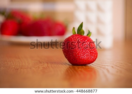 ripe strawberry on a wooden surface. fruit background