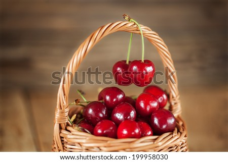 Ripe Sweet Cherries in Wicker Basket