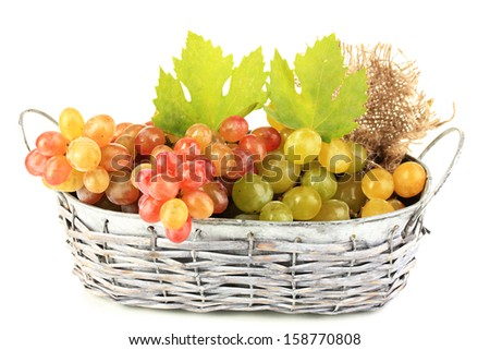 Ripe sweet grape in basket, isolated on white