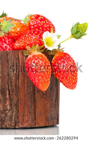 Ripe sweet strawberries in the wooden basket isolated on white background - stock photo