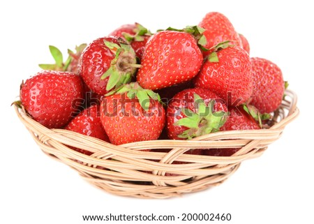 Ripe sweet strawberries in wicker basket isolated on white