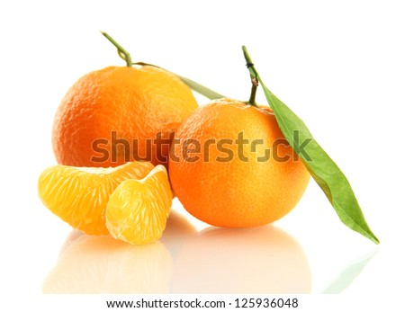 Ripe sweet tangerine with leaves, isolated on white - stock photo