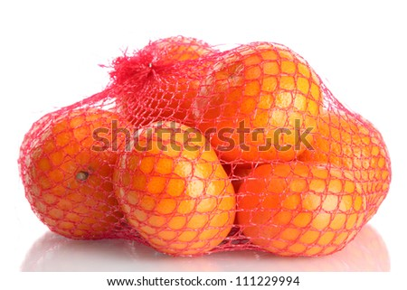 ripe tangerines in bag isolated on white