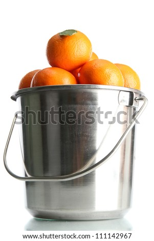 ripe tangerines in metal bucket isolated on white