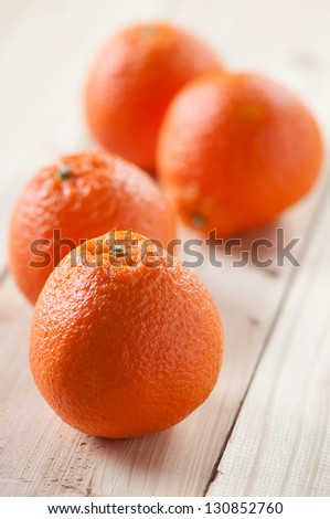 Ripe tangerines on wooden boards, vertical shot