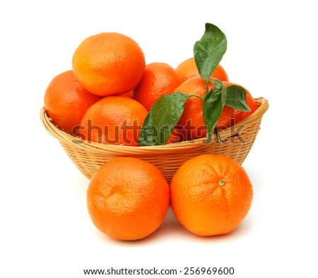 Ripe tangerines or mandarin with leaf isolated in basket on white background  - stock photo