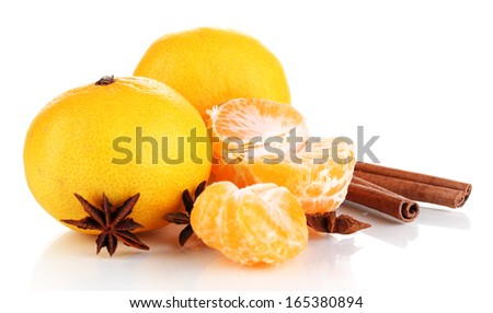 Ripe tangerines with cinnamon isolated on white