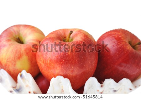 Ripe tasty red apples are isolated on white