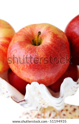 Ripe tasty red apples in white vase