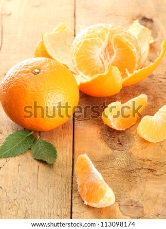 Ripe tasty tangerines on wooden background - stock photo