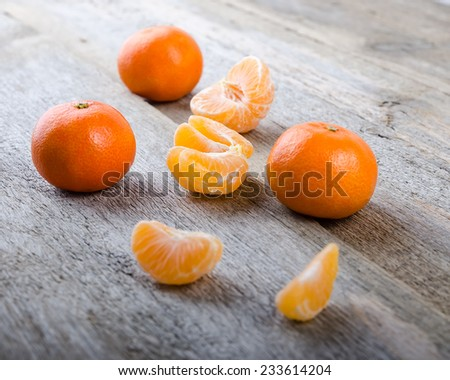 Ripe tasty tangerines on wooden background