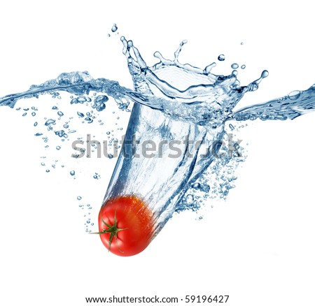 Ripe tomato falls deeply under water with a big splash. - stock photo
