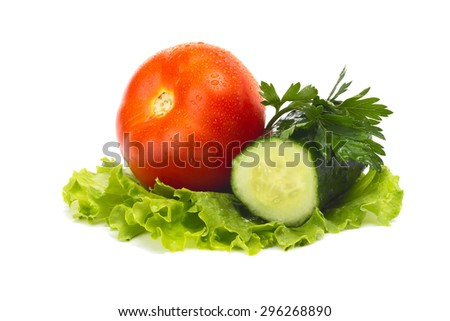 ripe tomatoes and cucumber in a salad leaf on white background