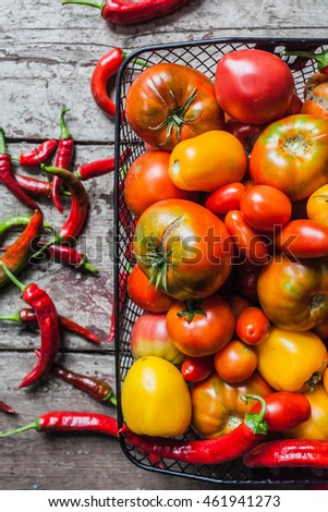 ripe tomatoes and hot peppers