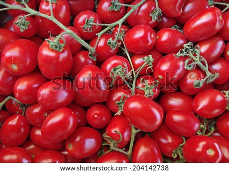 Ripe tomatoes at a farmers market in Sicily, Italy. - stock photo
