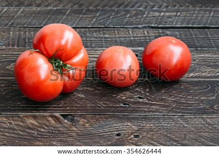 Ripe tomatoes. Three tomatoes, tomatoes on the table, juicy tomatoes, red tomatoes - stock photo