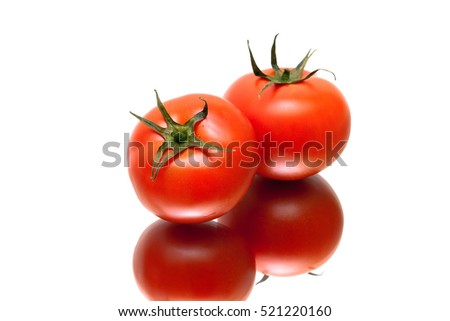 ripe tomatoes with reflection on white background. horizontal photo.
