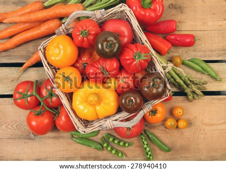 Ripe vegetables on wooden table - stock photo