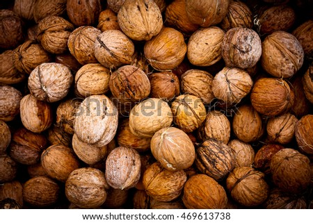 ripe walnuts - abstract natural background