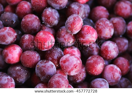 Ripe wet plums texture