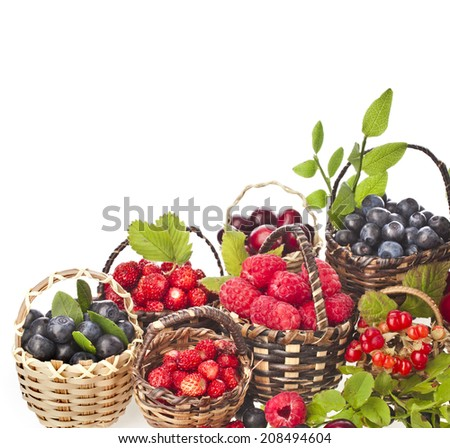 ripe wild berries mix in the basket isolated on white background - stock photo