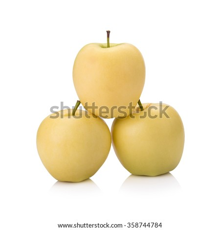 ripe yellow apple isolated on white.