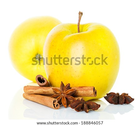Ripe yellow apples with cinnamon sticks and  anise star