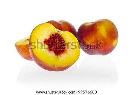 Ripe yellow-flesh peaches. - stock photo