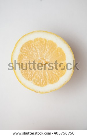 Ripe yellow lemons on cutting - stock photo