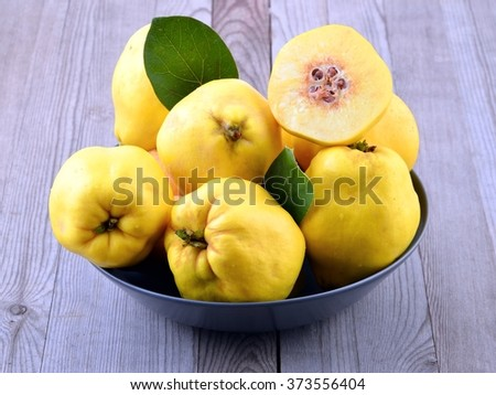 Ripe yellow quinces - stock photo