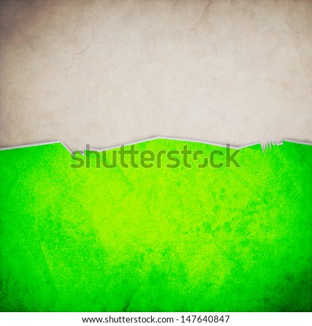 Riped old paper on grunge wall background