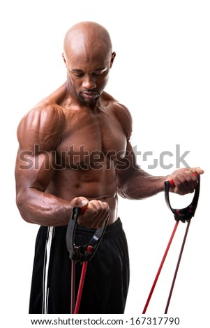 Ripped body builder working out his biceps using a resistance band.  - stock photo