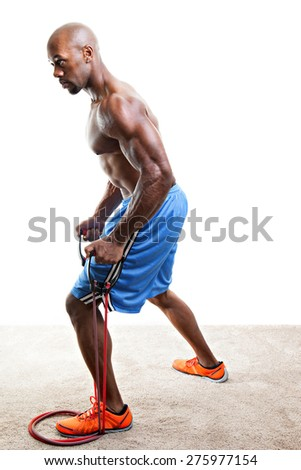 Ripped body builder working out using a resistance band. - stock photo