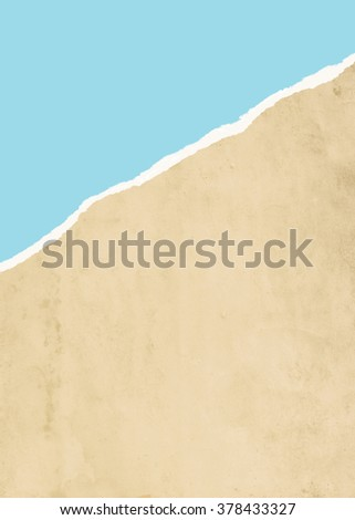 Ripped brown paper with blue sky background