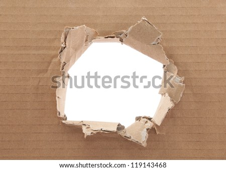 Ripped hole in cardboard on white background - stock photo