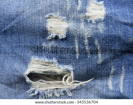 Ripped jeans. Close up. - stock photo