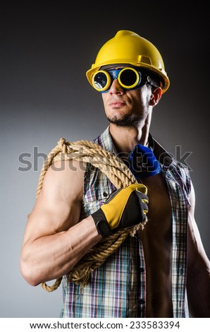 Ripped muscular builder man with tools - stock photo