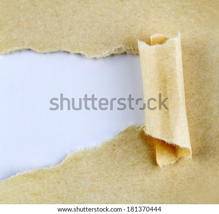 Ripped paper on blue background - stock photo