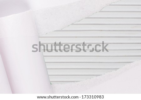 ripped paper on fabric  background