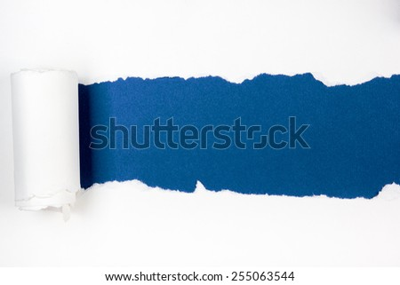 Ripped paper, space for copy on blue background - stock photo