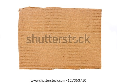 Ripped piece of cardboard isolated on white background - stock photo