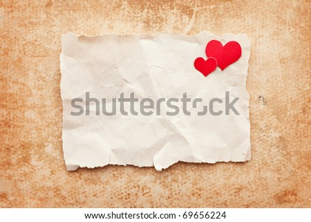 Ripped piece of paper on grunge paper background. Love letter - stock photo